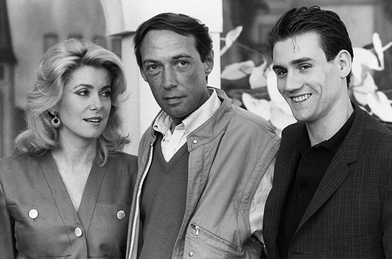 Photo: Catherie Deneuve, André Téchiné,  Wadeck Stanczak, Festival de Cannes, 1986. AFP Photo ©