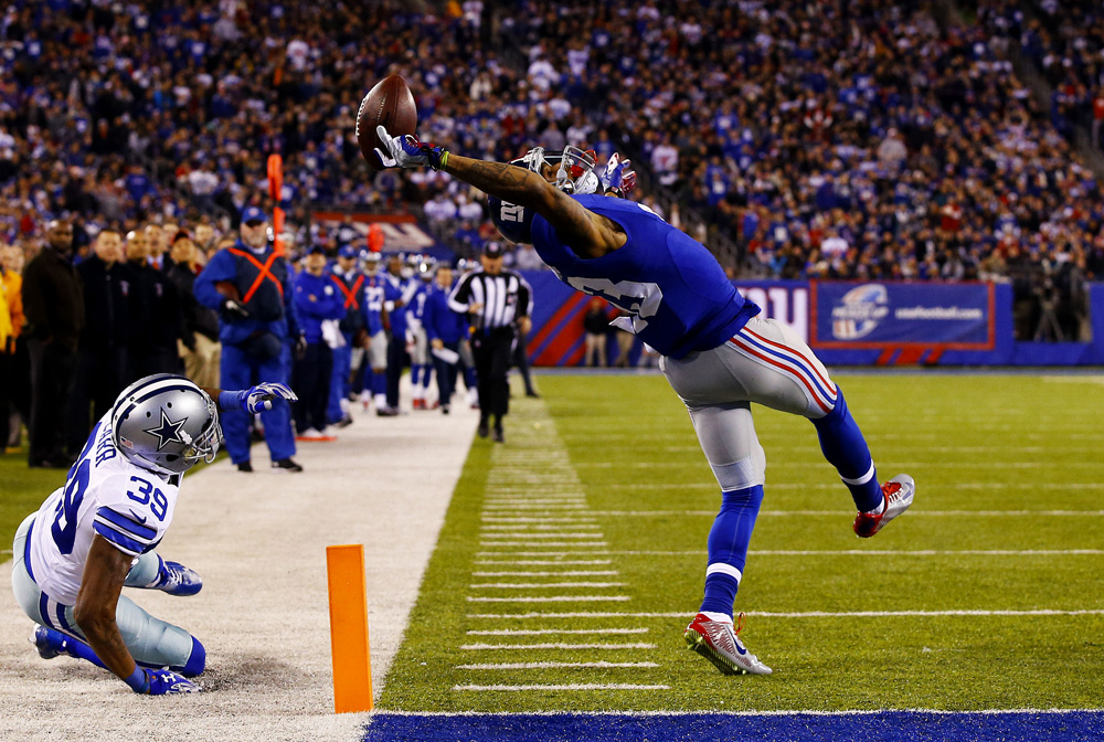 Catégorie Sports : Al Bello Odell Beckham, des New York Giants, marque un touchdown pendant un match contre les Cowboys de Dallas, à East Rutheford (New Jersey) le 23 novembre 2014.