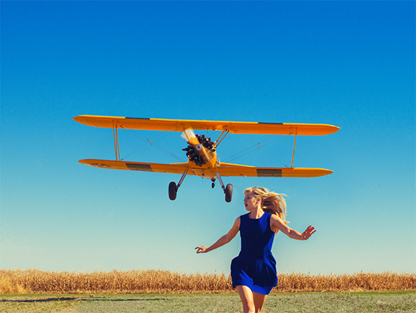Girl running from plane Photo : Tyler Shields
