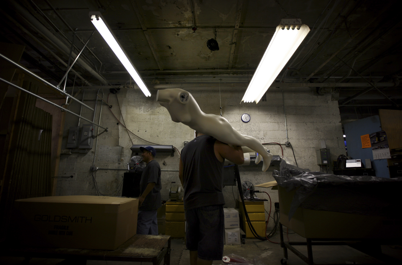 THIS IS ONE OF A SERIES OF 15 PHOTOS BY ASSOCIATED PRESS PHOTOGRAPHER ODED BALILTY--A Goldsmith employee carries a mannequin at the Goldsmith factory in New York Tuesday, Sept. 4, 2007. As Fashion Week gets underway in New York, rail thin models will still be on the runways, but when garments reach the stores, many of them will be displayed on mannequins that more realistically reflect the human form - and the shapes of customers shopping for clothes. Goldsmith also has a line of full-figured mannequins.(AP Photo/Oded Balilty)