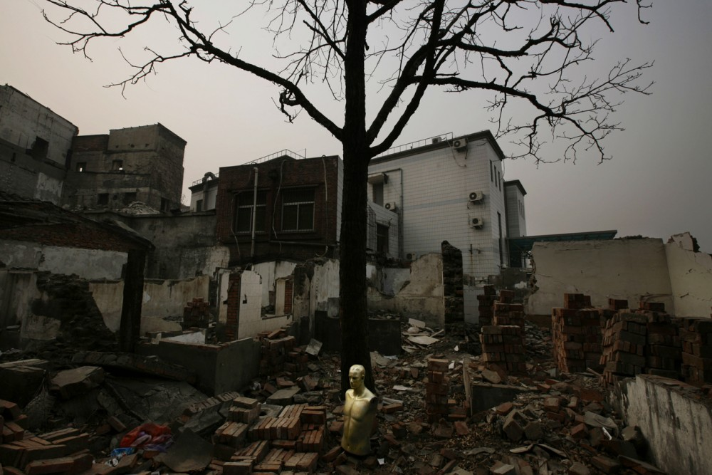 A mannequin sits amongst the rubble of a demolished house in Beijing Wednesday, Dec. 26, 2007. Large swathes of the city are being demolished, to be replaced by modern commercial and residential complexes as the city modernizes in preparation for the 2008 Olympic Games. (AP Photo/Oded Balilty)