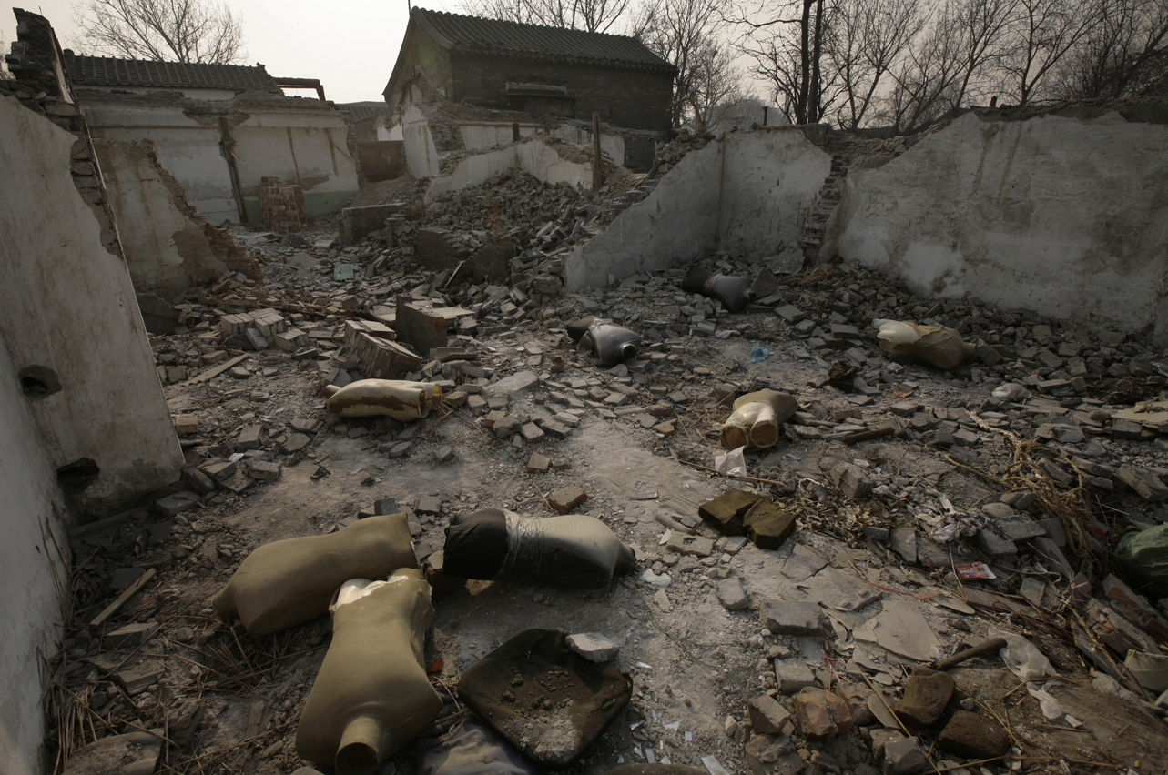 Mannequin lay amongst the rubble of a demolished house in Beijing, China, Wednesday, Dec. 19, 2007.Large swathes of the city are being demolished, to be replaced by modern commercial and residential complexes as the city modernizes in preparation for the 2008 Olympic Games.(AP Photo/Oded Balilty)