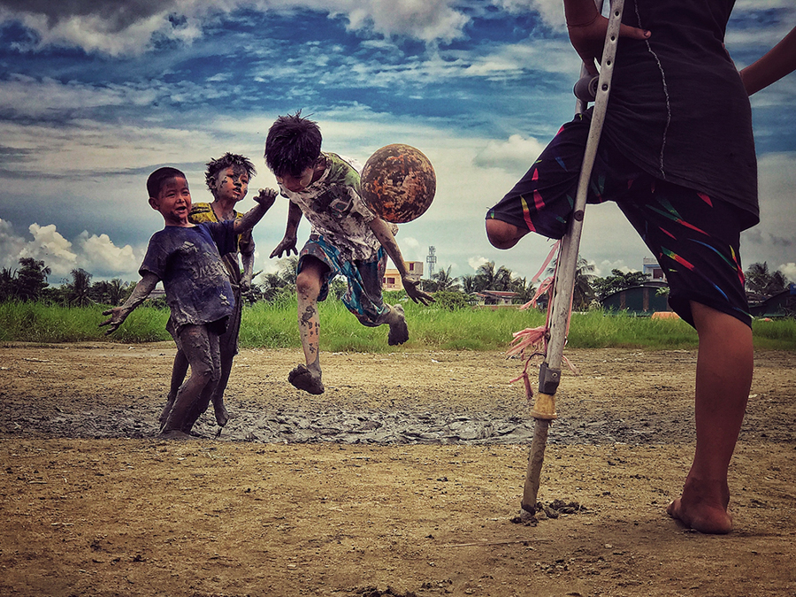 "Zarni Myo Win Myanmar 3rd Place, Photographer of the Year I want to play ""A young boy who lost his leg was watching his friends play soccer, and he said he wanted to play soccer if he could."" Location: Yangon, Myanmar Shot on iPhone 7 Plus"
