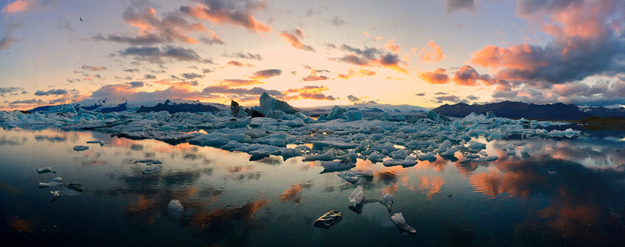 "Mateusz Piesiak Poland 1st Place – Panorama Icebergs ""In summer the sun is above the horizon nearly all day where Vatnajökull glacier meets the Atlantic Ocean."" Location: Iceland Shot on iPhone 6 Plus"